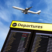 Airport flight information and airplane departing — Stock Photo