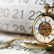 Gold pocket watch and calendar — Stock Photo #63474163