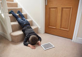 Child falling down the stairs — Stock Photo