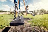 Empty playground swing — Stock Photo