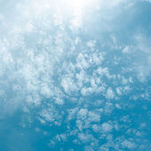 Blue sky with sun and cloud — Stock Photo