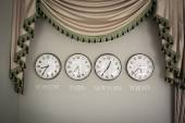 Clocks on a wall with time zone of different country — Stock Photo