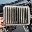 Technician holding the  dirty air filter — Stock Photo #73979875