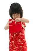 Asian baby holding ang pow or red packet monetary gift — Stock Photo