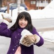 Cute asian girl smiling outdoors in snow — Stock Photo #74027023