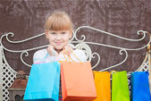 Smiling  little  girl  after shopping  — Stockfoto