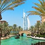 Burj Al Arab hotel Madinat Jumeirah in Dubai with palm trees — Stock Photo #65604513