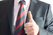 Business man showing a gesture — Stock Photo