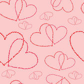 Seamless background with stylized hearts — Stockvektor