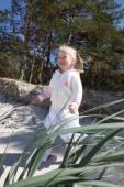 Blond girl on the beach — Стоковое фото