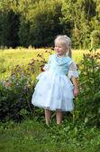 Cute girl on summer meadow — Stock Photo