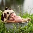 Smililng Baby Boy Wearing a Puppy Dog Hat — Stock Photo #57473621