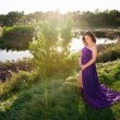 Maternity Portrait of a Woman Near a Lake's Edge — Stock Photo #63337813