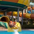 Couple rides in the water park — Stock Photo #65757243
