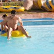 Couple rides in the water park — Stock Photo #65757255