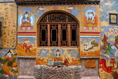 Large city streets of Lijiang Naxi myths and legends mural art — Stock Photo