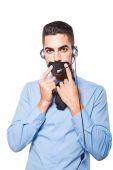 Male operator, handsome hispanic man in formal wear — Stock Photo