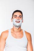 Homem bonito com creme de barbear — Fotografia Stock
