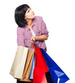 Young brunette woman with shopping bags — Stock Photo