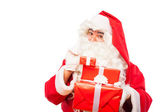 Santa claus with gifts isolated on white, with copy space — Stockfoto