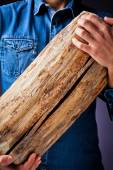 Young man with the wooden trunk — Stock Photo