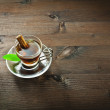 Hot tea and cinnamon in the cup — Stock Photo #68779083