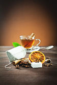 Aromatic spices and tea bag — Stock Photo