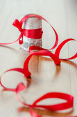 Thai bath with red ribbon for concept gift of money — Stock Photo
