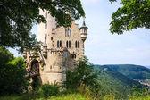 Lichtenstein castle behind trees — Stock Photo