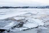 Thin ice at lake — Stock Photo