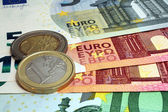 Euro banknotes and coins 2014 — Stock Photo