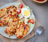 Chicken breast with a cheese crust — Stock Photo