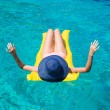 Woman relaxing on inflatable mattress in the sea — Stock Photo