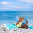 Adorable little girl with big map on tropical beach vacation — Stock Photo #52851147