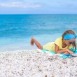 Adorable little girl with big map on tropical beach vacation — Stock Photo #52851153