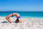 Cute little sporty girl on white tropical beach and having fun — Stock Photo