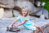 Little adorble happy girl with a turtle outdoors — Foto de Stock