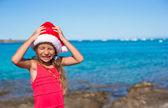 Cool beautiful little girl in Santa hat very happy — Stock Photo