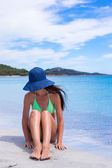 Young beautiful woman relaxing at white sand tropical beach — Stock Photo