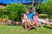 Father and kids at tropical beach vacation having fun outdoor — Stock Photo