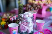 Marshmallow, sweet colored meringues, popcorn, custard cakes and cake pops on table — Stock Photo