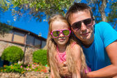 Portrait of father and little daughter at tropical vacation having fun outdoor — Stock Photo