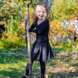 Cute little girl in Halloween which costume have fun outdoor — Stock Photo #54250375
