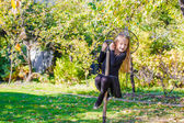 Adorable little girl in Halloween which costume having fun outdoors — Stock Photo
