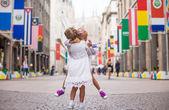 Little beautiful girls walking in Milan — Stock Photo