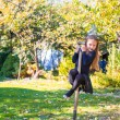 Adorable little girl in Halloween which costume having fun outdoors — Stock Photo #56087575
