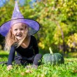 Cute little girl in Halloween which costume have fun outdoor — Stock Photo #56087997