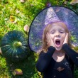 Cute little girl in Halloween which costume have fun outdoor — Stock Photo #56088057
