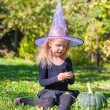 Cute little girl in Halloween which costume have fun outdoor — Stock Photo #56088155