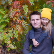 Adorable little girl with happy father having fun in autumn park on a sunny day — Stock Photo #56088223